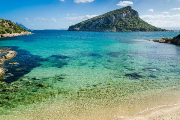 Cala Moresca bay and Figarolo island on background.