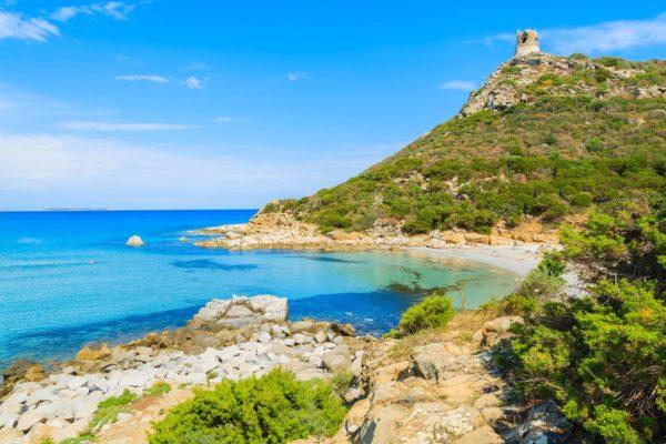 Crystal clear water of Porto Giunco bay with sandy beach, Sardinia island, Italy